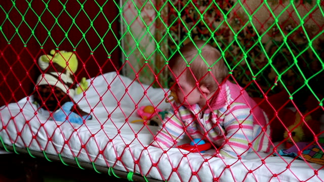 Crying baby crawls in the crib video