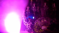 Crystal chandelier with golden garlands and soundlights FullHD video