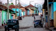 Cuba: Travel : Vintage cars on street in Trinidad old town, Cuba video
