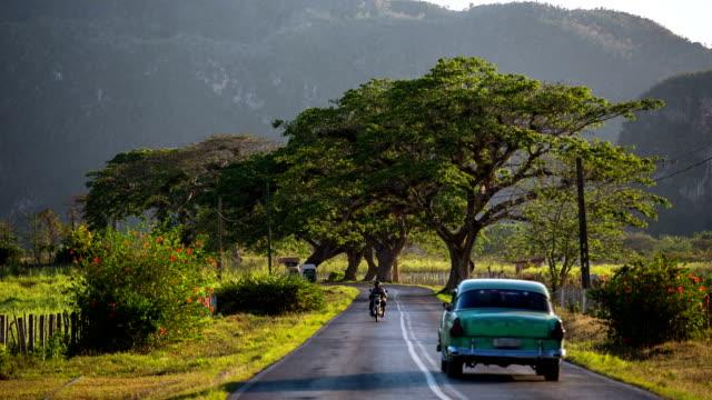 Cuba , Vintage car driving on rural road video