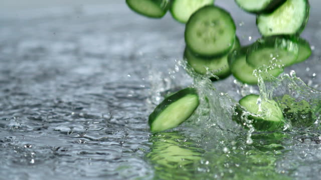cucumbers splashing and bouncing on water video