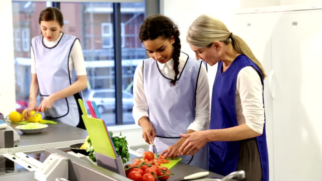Culinary School Intructor Teaching Students in Commercial Kitchen video