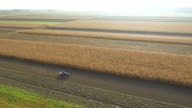 AERIAL Cultivating The Field With Tractor video