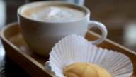 cup of coffee and cookie in coffee shop video