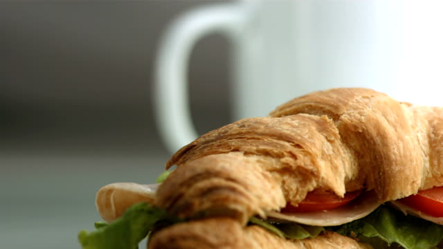 HD: Cup Of Coffee And Croissant Sandwich video