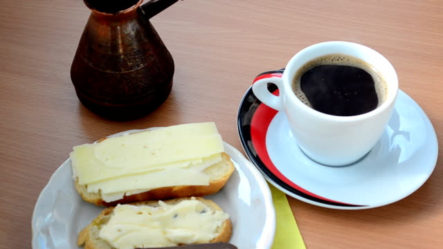 Cup of coffee and sandwiches video