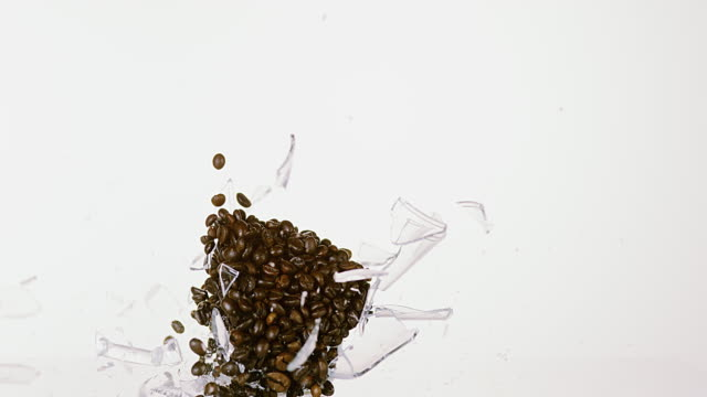 Cup of Coffee Breaking against White Background, Slow motion 4K video