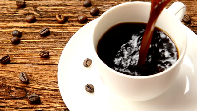 A cup of coffee milk and coffee beans. video