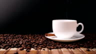 Cup of coffee on black background video