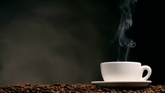 Cup of coffee over dark background video