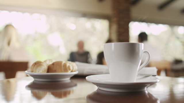 Cup of coffee with croissant video