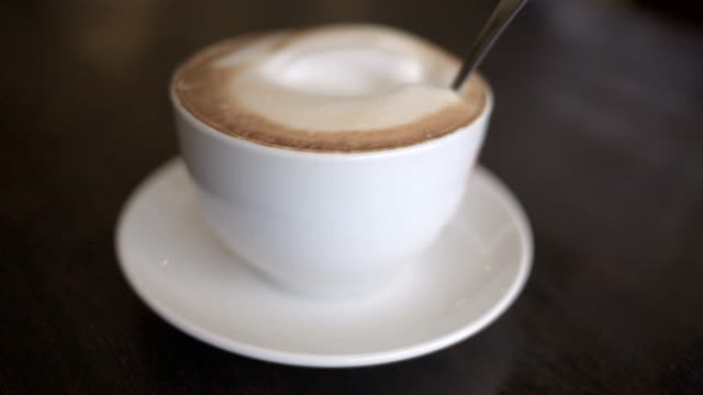 Cup of fresh roasted cappuccino. video