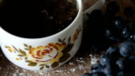cup of hot black leafy tea video
