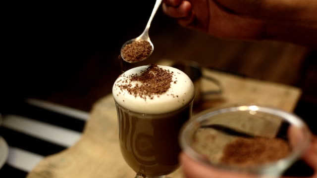 Cup of hot coffee with shaved chocolate and whipped cream video