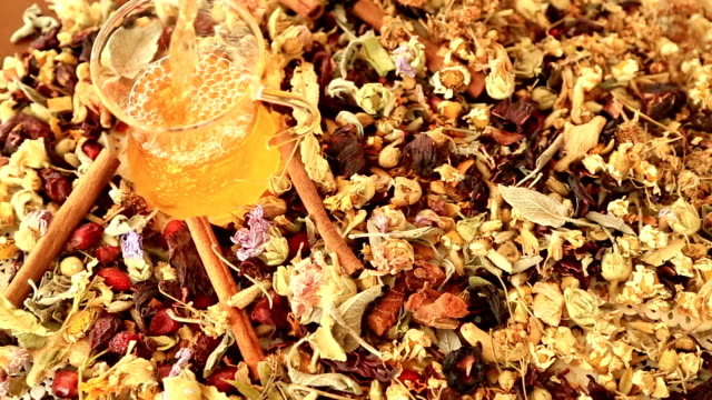 Cup of tea with different kind of healing herbs video