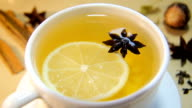 Cup of tea with lemon and anise video