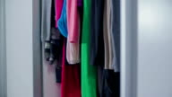 Cupboard full of dresses video