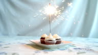 Cupcake with bow and candle. happy birthday card. Holidays greeting card. video