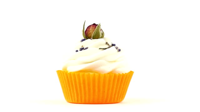 Cupcake with rose in front of white background video