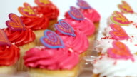 Cupcakes with swirl icing rotating in a tray. Tight shot. video