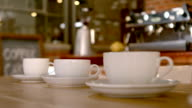 Cups and saucers on cafe table video