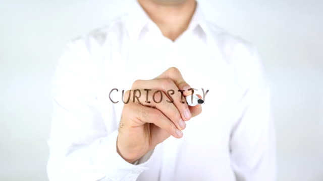 curiosity, Man Writing on Glass video