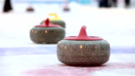 Curlers throw stones for curling on ice. video