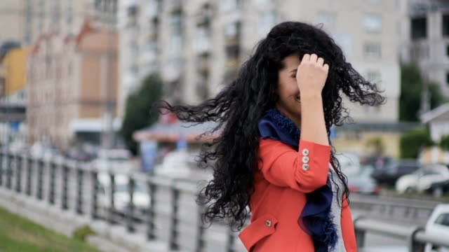 Curly lady whirles at the road background video