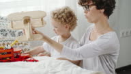 Curly Mother and Toddler Playing Together video