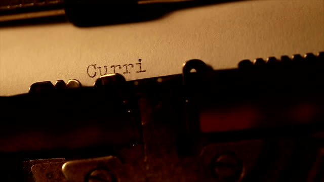 'curriculum vitae' typed using an old typewriter video