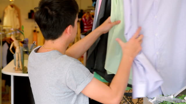 Customer choosing clothes in a boutique video