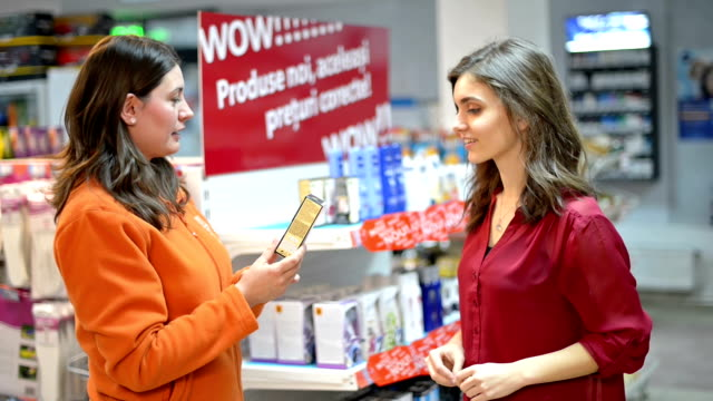Customer choosing cosmetic products in supermarket video
