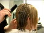 Customer getting her haircut at the Hair salon video