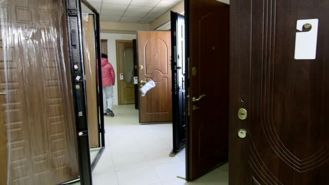 Customer in the doors store showroom looking for armored  front door video