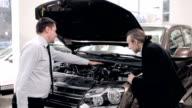 Customer inspecting car engine video