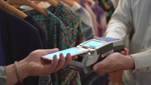 Customer making contactless payment with smart phone video