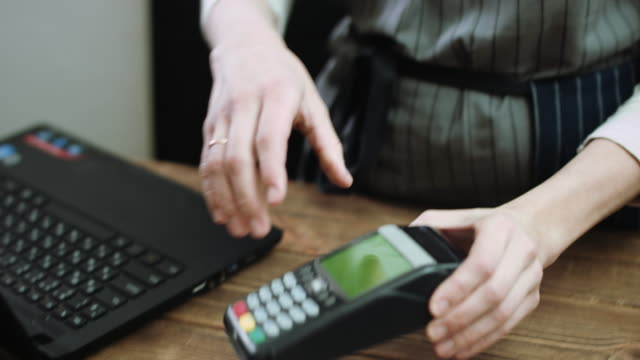 Customer paying with credit card video