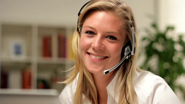 Customer service operator smiling, looking at camera video