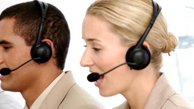 Customer service representatives showing diversity video