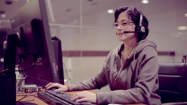 Customer service woman talking on headsets video