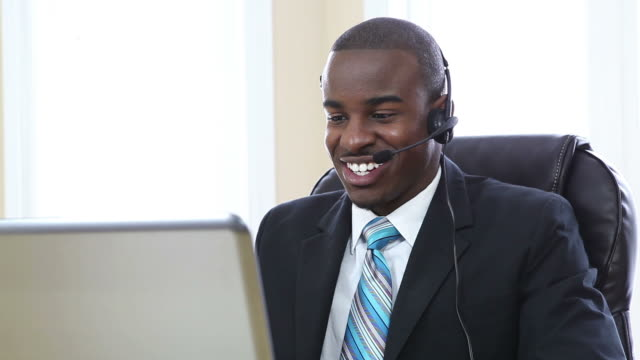Customer support operator smiling and speaking in office video