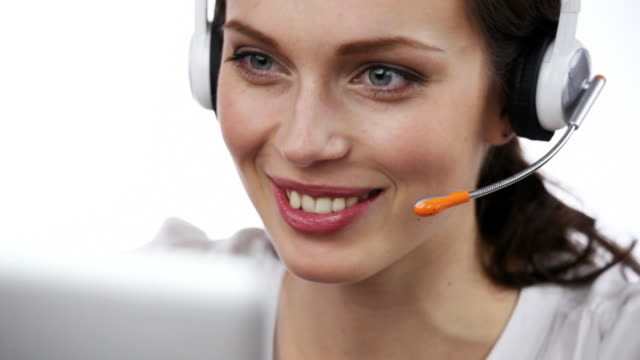 Customer support operator smiling, speaking, looking at camera, on white video
