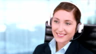 Customer support operator. Telemarketer. Young woman working in a call center. video