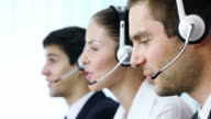 Customer support operators working at office video
