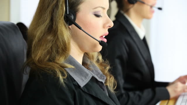 Customer support operators working video