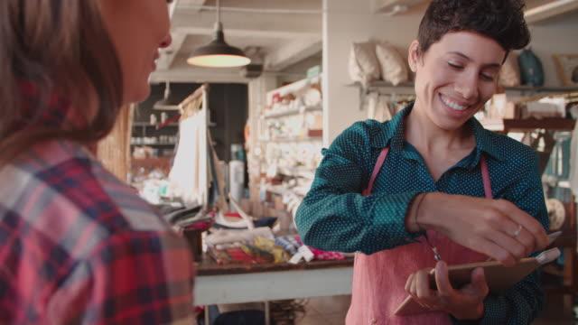 Customer Using Card Reader On Digital Tablet Shot On R3D video