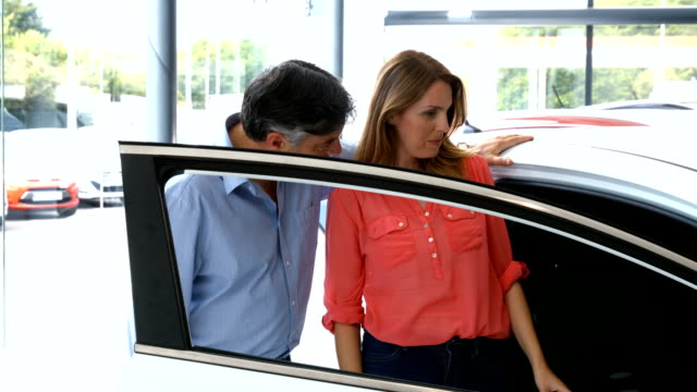 Customers checking out their new car video