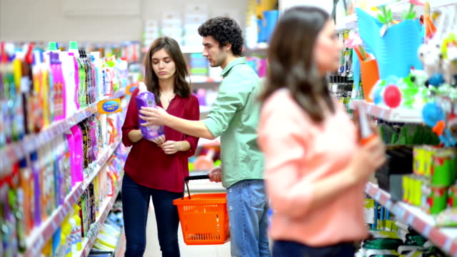 Customers choosing cleaning products in supermarket video