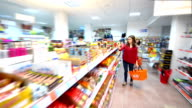 Customers choosing products in supermarket video