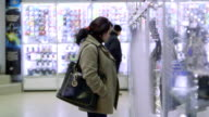 DOLLY: Customers in electronics store video